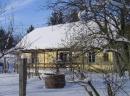 Haus Jani unter Schnee